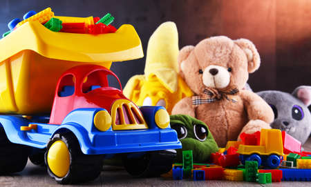 Colorful plastic and plush toys in a children's room. Standard-Bild