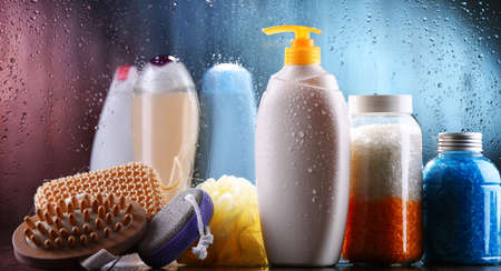 Different containers of body care products in the bathroom.