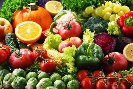 Composition with variety of fresh organic vegetables and fruits Stock Photo