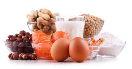 Composition with common food allergens including egg, milk, soya, peanuts, hazelnut, fish, seafood and wheat flour Stock Photo