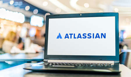 POZNAN, POL - SEP 23, 2020: Laptop computer displaying logo of Atlassian Corporation, an Australian software company that develops products for software developers and project managers