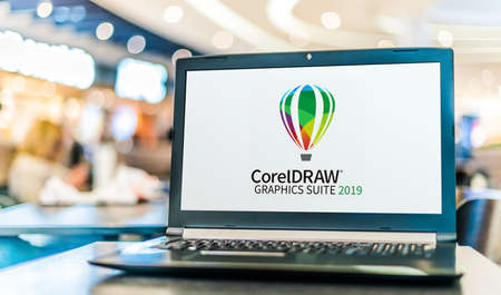 POZNAN, POL - SEP 23, 2020: Laptop computer displaying logo of CorelDraw Graphics Suite, a vector graphics editor developed and marketed by Corel Corporation