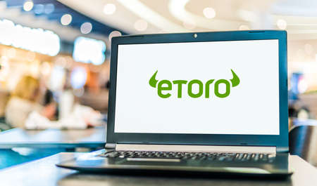 POZNAN, POL - JAN 6, 2021: Laptop computer displaying logo of eToro, an Israeli social trading and multi-asset brokerage company that focuses on providing financial and copy trading services