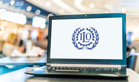 POZNAN, POL - NOV 12, 2020: Laptop computer displaying logo of The International Labor Organization (ILO), a United Nations agency whose mandate is to advance social and economic justice
