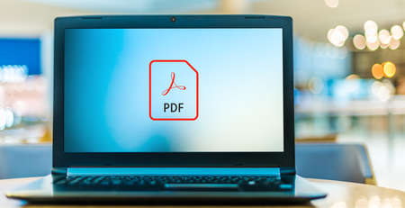 POZNAN, POL - NOV 12, 2020: Laptop computer displaying logo of Adobe Acrobat file, a family of application software and Web services developed by Adobe Inc.