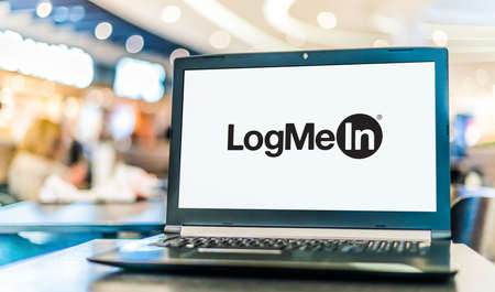POZNAN, POL - NOV 12, 2020: Laptop computer displaying logo of LogMeIn, a provider of software as a service and cloud-based remote work tools for collaboration, IT management and customer engagement