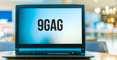 POZNAN, POL - JAN 6, 2021: Laptop computer displaying logo of 9GAG, an online platform and social media website, which allows its users to upload and share