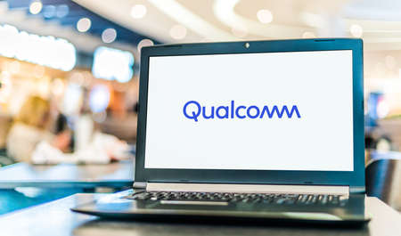 POZNAN, POL - NOV 12, 2020: Laptop computer displaying logo of Qualcomm, a corporation that creates intellectual property, semiconductors, software, and services related to wireless technology 新聞圖片