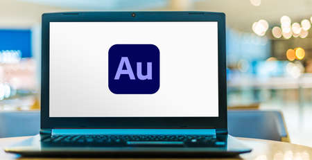 POZNAN, POL - AUG 8, 2020: Laptop computer displaying logo of Adobe Audition, a digital audio workstation from Adobe Systems