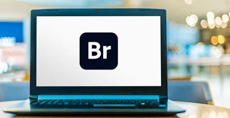 POZNAN, POL - AUG 8, 2020: Laptop computer displaying logo of Adobe Bridge is a free digital asset management app made by Adobe Systems