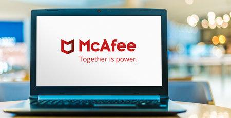 POZNAN, POL - SEP 23, 2020: Laptop computer displaying logo of McAfee, a global computer security software company headquartered in Santa Clara, California, USA