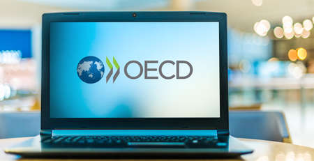 POZNAN, POL - JAN 6, 2021: Laptop computer displaying logo of OECD, an intergovernmental economic organization founded in 1961 to stimulate economic progress and world trade