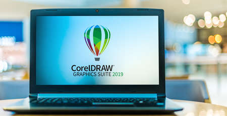 POZNAN, POL - SEP 23, 2020: Laptop computer displaying of CorelDraw Graphics Suite, a vector graphics editor developed and marketed by Corel Corporation
