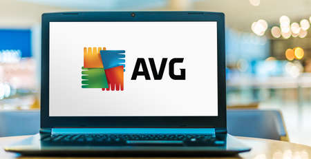 POZNAN, POL - AUG 8, 2020: Laptop computer displaying logo of AVG AntiVirus, a line of antivirus software developed by AVG Technologies, a subsidiary of Avast