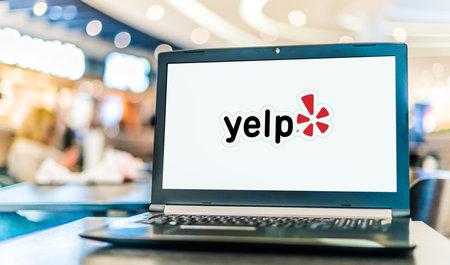 POZNAN, POL - JAN 6, 2021: Laptop computer displaying logo of Yelp, an American public company headquartered in San Francisco, California