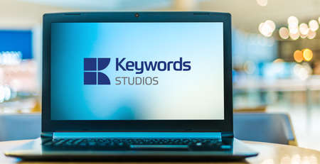 POZNAN, POL - JAN 6, 2021: Laptop computer displaying logo of Keywords Studios, an Irish video game industry services company based in Leopardstown