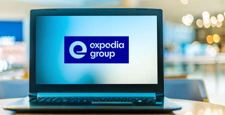 POZNAN, POL - AUG 8, 2020: Laptop computer displaying logo of Expedia Group, an American online travel shopping company for consumer and small business travel