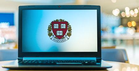 POZNAN, POL - JAN 6, 2021: Laptop computer displaying logo of Harvard University, a private Ivy League research university in Cambridge, Massachusetts Editorial