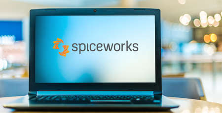 POZNAN, POL - NOV 12, 2020: Laptop computer displaying logo of Spiceworks, a professional network for the information technology (IT) industry that is headquartered in Austin, Texas 新聞圖片