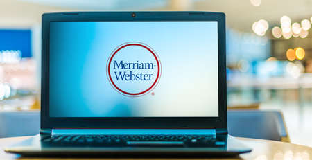 POZNAN, POL - JAN 6, 2021: Laptop computer displaying logo of Merriam-Webster, an American company that publishes reference books and dictionaries