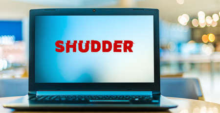 POZNAN, POL - JAN 6, 2021: Laptop computer displaying logo of Shudder, an American over-the-top subscription video on demand service featuring horror, thriller and supernatural fiction titles