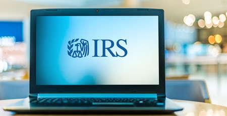 POZNAN, POL - JAN 6, 2021: Laptop computer displaying logo of The Internal Revenue Service (IRS), the revenue service of the United States federal government