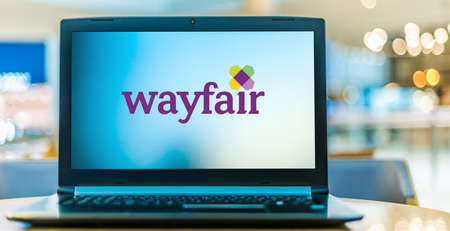 POZNAN, POL - AUG 8, 2020: Laptop computer displaying logo of Wayfair, an American e-commerce company that sells furniture and home-goods