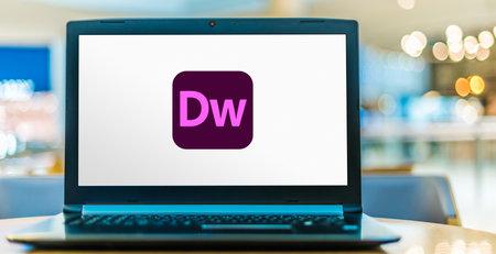 POZNAN, POL - AUG 8, 2020: Laptop computer displaying logo of Adobe Dreamweaver, a proprietary web development tool from Adobe Inc