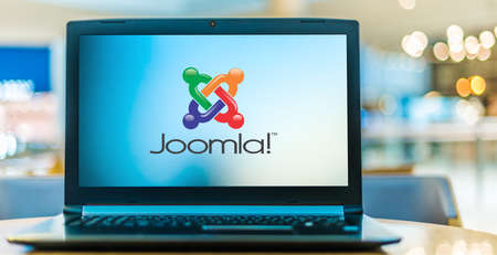 POZNAN, POL - JAN 6, 2021: Laptop computer displaying logo of Joomla, a free and open-source content management system (CMS) for publishing web content on websites