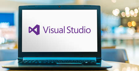 POZNAN, POL - JUL 25, 2020: Laptop computer displaying logo of Microsoft Visual Studio, an integrated development environment (IDE) from Microsoft