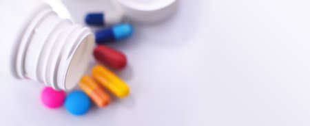 Composition with variety of drug pills and container. Imagens