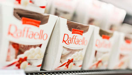 POZNAN, POL - APR 13, 2021: Boxes of Raffaello, a brand of coconut-almond praline manufactured by Ferrero SpA, chocolate producer and confectionery company headquartered in Alba, Piedmont, Italy Editorial