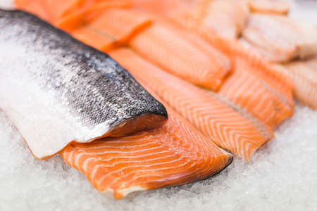 Fresh fish fillet put up for sale in a supermarket refrigerator 版權商用圖片