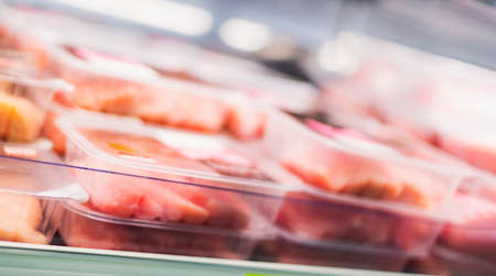 Meat products put up for sale in a supermarket commercial refrigerator