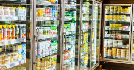 POZNAN, POL - APR 13, 2021: Food products put up for sale in a commercial refrigerator