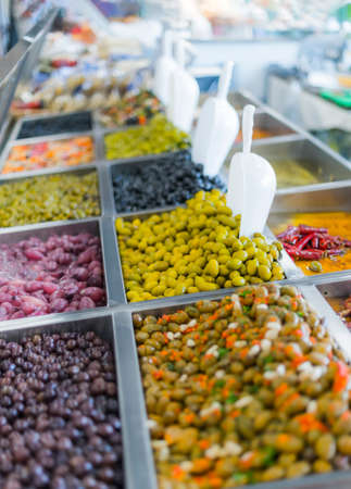 Fresh olives put up for sale in a supermarket.