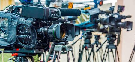Professional tv cameras on tripods recording social event on the street Archivio Fotografico