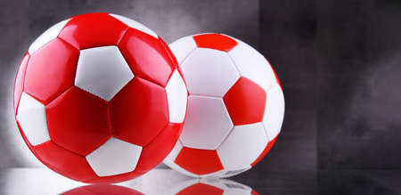 Composition with two leather soccer balls 写真素材