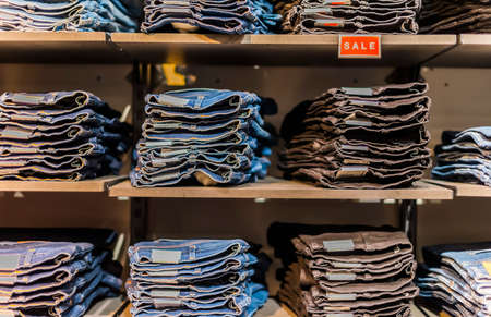 POZNAN, POL - MAY 28, 2021: Clothing products on the shelf in a clothing store.