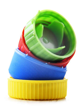 Colorful plastic bottle caps isolated on white. Recycling