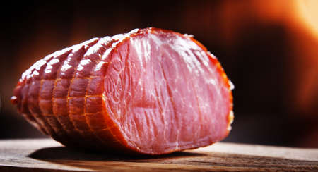 Piece of smoked ham. Meatworks product 写真素材