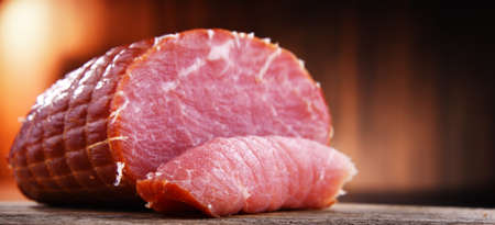 Piece of smoked ham. Meatworks product Standard-Bild