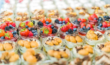 Assorted bio desserts presented in a cafe refrigerator 版權商用圖片