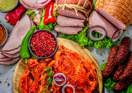 Composition with assorted meat products including ham, sausage and chuck steak