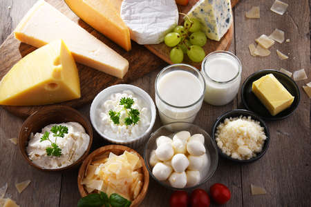A variety of dairy products including cheese, milk and yogurt. 版權商用圖片
