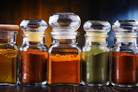 Glass storage jars with spices and herbs.