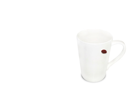 White coffee cup with a coffee seed on white background. Relax lifestyle.