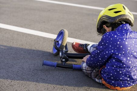 Little boy fell off bike (balance bike).