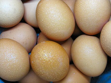 Eggs have water droplets on basket