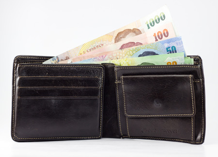 tight filled: black wallet with thai money